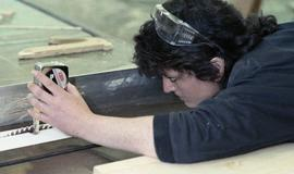 BCIT Women in Trades; carpentry, woman with measuring tape [1 of 2 photographs]