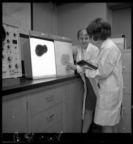 B.C. Vocational School image of an instructor and student viewing an image on electronic equipmen...