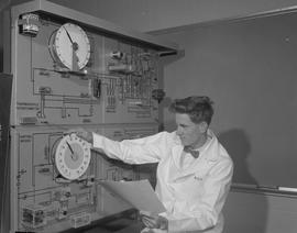 Instrumentation, 1966; a man in a lab coat using circuit testing equipment [1 of 2]