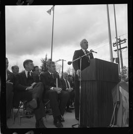 Merger of BCIT and PVI celebrations April 1986; man talking at outdoor podium [3 of 4 photographs]