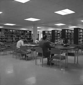 BCIT Burnaby campus library ; people sitting at desks ; library stacks [1 of 3]