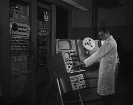 BCIT Broadcast and Television, 1966; man using audio/video editing equipment [1 of 2]