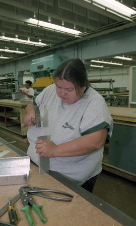 Pre-trade Aboriginal women; sheet metal, students using materials and equipment in class [9 of 11...