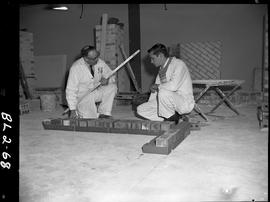 B.C. Vocational School image of Bricklaying students learning to lay bricks with an instructor gu...