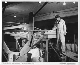 Pre-apprentice boatbuilders building a boom boat; Photo by the Division of Visual Education, Dept...