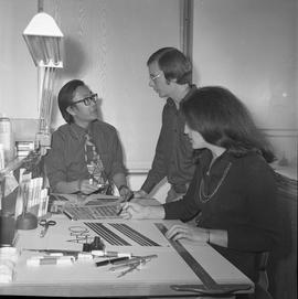 BCVS Graphic arts ; three people at a desk looking at illustrations [7 of 11]