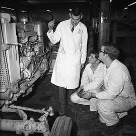 BCVS Heavy duty mechanic program ; two students and an instructor looking a tractor engine [2 of 3]
