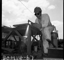 B.C. Vocational School image of a Boilermaker student cutting metal using a cutting torch