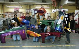 BCIT women in trades; fender, students holding painted car fenders inside a shop [2 of 9 photogra...