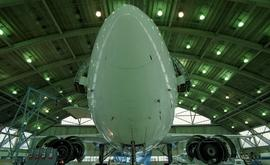 Front view of an airplane inside a hangar [4 of 4 photographs]