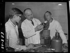 BC Vocational School image of an instructor and two students in the Appliance Servicing program l...