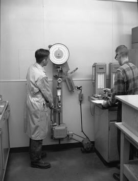 Forest Products, 1964; two men using forest products testing machinery [2 of 2]