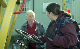 BCIT women in trades; forklift training, instructor beside a student driving a forklift [6 of 8 p...