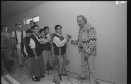 Coast Salish youths and BCIT students with instructor (?) holding power tools during gym construc...