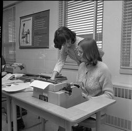 BC Vocational School Commercial Program; instructor talking to student typing