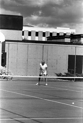 BCIT image of a man playing tennis on a BCIT Tennis court.