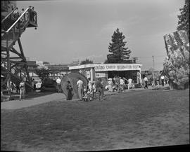 Logging, 1967; Logging Career Information Booth at the Vancouver PNE ; people and two large tree ...