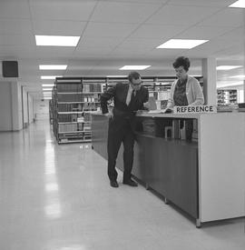 BCIT Library ; librarian and man at the reference desk [1 of 2]