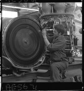 BC Vocational School; Aeronautics student working on aircraft engine inside the hangar in Burnaby.