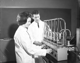 Food Processing Technology; two students in lab coats using food processing equipment [2 of 2]