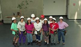 Pre-trade Aboriginal women; students wearing hard hats and tool belts [2 of 8 photographs]