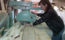 BCIT Women in Trades; carpentry, woman using band saw [2 of 2 photographs]