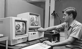 Computer Based Education (CBE)/Interactive Videodisc Project (IVD), Project publicity, man workin...