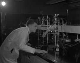 Food Processing Technology, 1966; man in a lab coat looking at liquid boiling in beakers