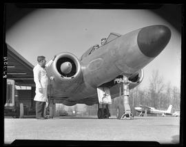 BC Vocational School image of a jet aircraft, Aeronautics instructor and students outside the han...