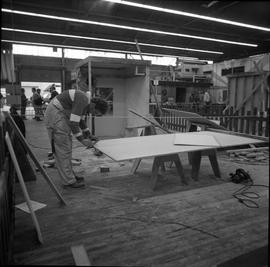 Carpentry apprenticeship contest, Burnaby campus, 1978 ; apprentice measuring their project