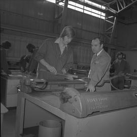 Sheet metal, 1968; instructor talking to a student ; people working in workshop in background