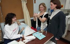 General Nursing, students with dummy patient and hospital bed [4 of 4 photographs]