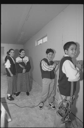 Coast Salish youths using power tools during gym construction [1 of 8 photographs]