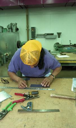 Pre-trade Aboriginal women; sheet metal, students using materials and equipment in class [3 of 11...