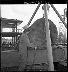 B.C. Vocational School Boilermaker student working on metal pipes; students working from scaffold...