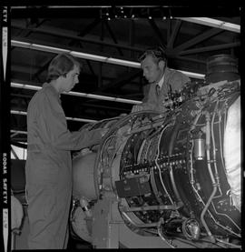 BC Vocational School; Aeronautics student and instructor working on an aircraft engine inside the...