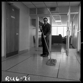 B.C. Vocational School image of Building Service Worker program student sweeping a floor