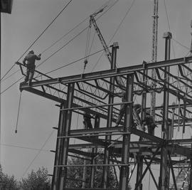 Structural steel, 1971; men working on a steel structure [2 of 3]
