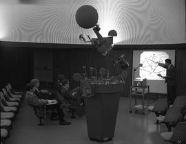 Survey, 1968; photogrammetry and astronomy instructor, Mr. Chiat, lecturing to five students (Bru...