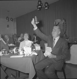Roy Brown retirement party; Roy Brown holding a gifted beer stein; Mrs. Brown and other attendees...