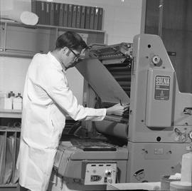 BCVS Graphic arts ; a man pulling paper out of a printing press [2 of 2]
