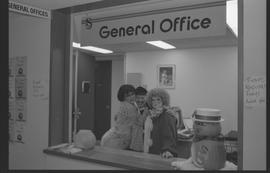 General Office staff dressed as a housewife (?), clown, and priest [7 of 11 photographs]