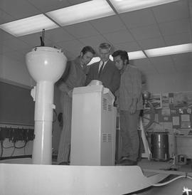 Navigation, 1968; three men looking at a piece of navigation equipment [1 of 2]
