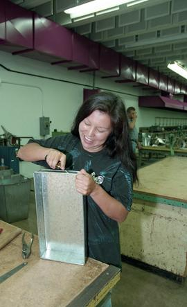 Pre-trade Aboriginal women; sheet metal, students using materials and equipment in class [5 of 11...