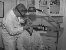 Industrial First Aid, Nanaimo; First Aid Attendant checking the mouth and throat of an industrial...