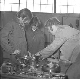 BCVS Heavy duty mechanic program ; an instructor showing students parts of a motor [1 of 3]
