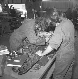 BCVS Heavy duty mechanic program ; two students working on a disassembled motor