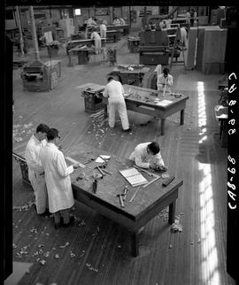 B.C. Vocational School image of the Carpentry Trades shop showing  some workbenches and equipment...