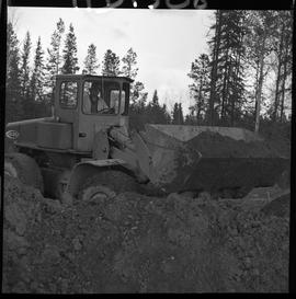 Heavy duty equipment operator, Nanaimo ; man operating a bulldozer moving dirt [4 of 9]