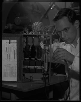 Mechanical technology, 1967; man in a lab coat using a testing device [2 of 2]